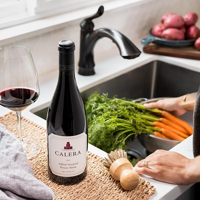 Calera Selleck Pinot Noir next to a sink with Veggies