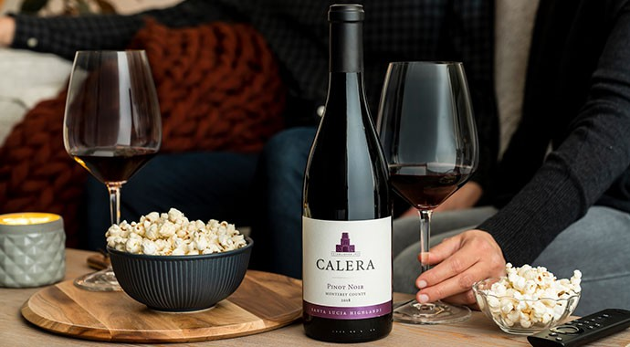 Calera wine bottle on coffee table with popcorn