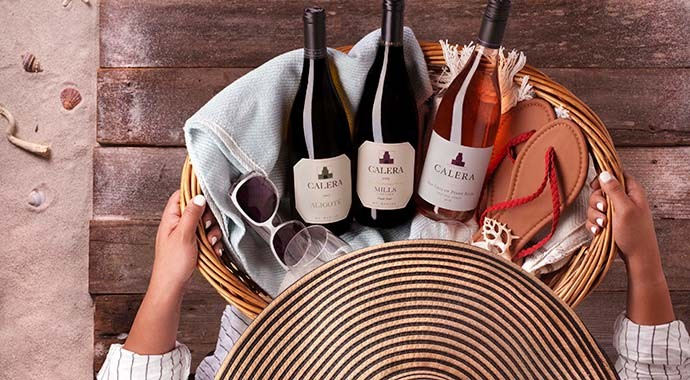Calera wines in a picnic basket at the beach