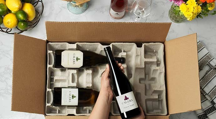 Calera wine delivery opened on kitchen counter