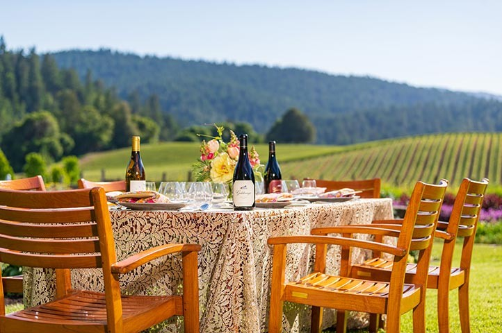 Goldeneye table outdoors with vineyard view